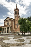 Santa Maria Assunta church in Cislago (Lombardy, Italy). Cislago (Varese, Lombardy, Italy): church of Santa Maria Assunta and the square stock image