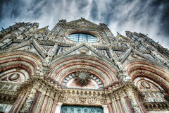 Santa Maria Assunta facade in Siena under a dramatic sky Royalty Free Stock Photo