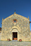 Santa Maria church in the old town of Monteriggioni, Italy Stock Photo