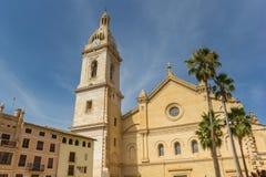 Santa Maria church and palm trees in the center of Xativa Stock Photos