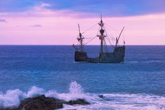 "Santa Maria de Colombo in open sea at sunset. The replica of Christopher Columbus's flagship ""SANTA MARIA"", built on Portuguese island of stock photography"