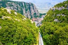 Santa Maria de Montserrat abbotskloster i Monistrol, i härlig sommardag, Catalonia, Spanien Fotografering för Bildbyråer