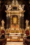 Santa Maria del Popolo Church. Rome. Italy. Worshipers and altar. Church of Santa Maria del Popolo in Piazza del Popolo in Rome, Italy. Some worshipers sat in Stock Photo
