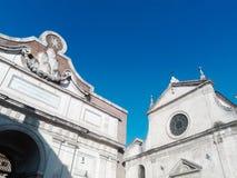 Santa Maria del Popolo and Popolo gate in Rome Stock Image