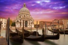 Santa Maria della Salute med gondoler Arkivbilder
