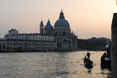 Santa Maria Della Salute, Venice. Scenic evening shot of a church in Venice, reflections and gondola boat on the water, venezia, italy Stock Image