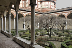 Santa maria delle grazie cloister, milan. Milan (Italy), 2011/02/27: foreshortening of ancient cloister of the famous church in city center, shot in winter Stock Image
