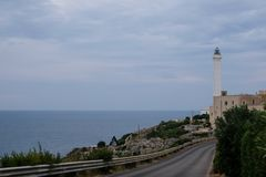 Santa Maria di Leuca, Italy. Iconic lighthouse located next to Basilica De Finibus Terrae where the Adriatic and Ionian seas meet. Santa Maria di Leuca, Italy stock images