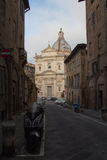 Santa Maria di Provenzano church at the end of street. Siena, Tuscany, Italy. Royalty Free Stock Photography