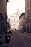 Santa Maria di Provenzano church at the end of street. Siena, Tuscany, Italy. Old polar effect. Royalty Free Stock Images