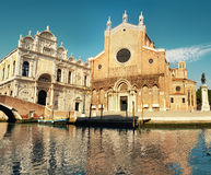 Santa Maria Gloriosa dei Frari at Venice, Italy. View from across the water. This image is toned Stock Photos