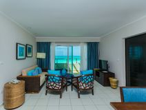 Inviting view of Golden Tulip hotel, cozy interior accommodation hotel guest room with ocean view stock photos