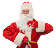 Santa measures the his waist. Close up of Santa Claus is measuring your waist, folding ruler isolated on white Royalty Free Stock Photography