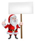 Santa Mechanic Sign. A Christmas cartoon illustration of Santa Claus holding spanner and sign post Stock Photos