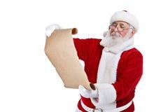 Santa med scrollpapper Fotografering för Bildbyråer
