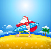 Santa med surfingbrädan Royaltyfri Fotografi