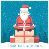 Santa  meditation and sitting on big present box in snow winter Royalty Free Stock Images