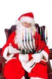 Santa and Menorah. Santa Claus holding a Hannukiah or Menorah for inter religion symbolism Stock Photography