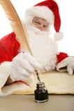 Santa mergulha seu Quill foto de stock