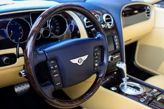 SANTA MESA, CA - JUNE 17, 2017: Evan Paul Motorcars Summer Bash: Open House. Close up view of Bently Steering wheel with beige interior royalty free stock photography