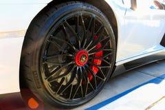 SANTA MESA, CA - JUNE 17, 2017: Evan Paul Motorcars Summer Bash: Open House. Close up view of car wheel with logo and braking system of a sports car stock photography
