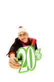 Santa middle aged woman, twenty percent discount. Attractive middle aged caucasian woman with santa hat, showing twenty percent discount sign. Studio shot. White Royalty Free Stock Image