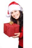 Santa mignonne avec le cadeau de Noël Image libre de droits