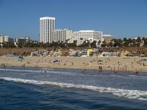 Santa Monica Beach. View of Santa Monica, CA beach from the pier showing waves, beach and cityscape background Stock Photo