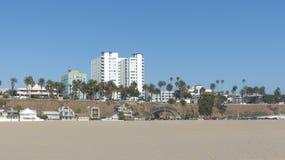 Santa Monica Beach. Deserted, wide beach of Santa Monica in the metropolitan area of Los Angeles, California, a footbridge to the beach, houses, holiday Stock Photography
