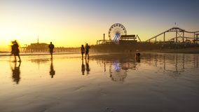 Santa Monica beach. And pier in California USA at sunset Stock Photos