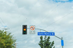 Santa Monica boulevard sign under a cloudy sky Stock Photo