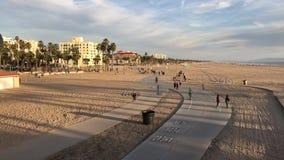 Santa Monica, CA USA - February 2017 Cruising Down Beach Sidewalk in Santa Monica stock footage
