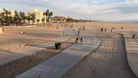 Santa Monica, CA USA - February 2017 Cruising Down Beach Sidewalk in Santa Monica stock video