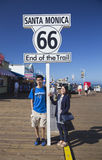 Santa Monica, California, USA 5/2/2015, asian couple pose at Route 66 sign Santa Monica Pier, end of famous Route 66 highway from  Royalty Free Stock Images