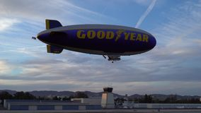 SANTA MONICA, CALIFORNIA USA - OCT 07, 2016: The Good Year blimp Zeppelin flies over airport. SANTA MONICA, CALIFORNIA USA - OCT 07, 2016: The Good Year blimp stock footage