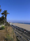 Santa Monica Coast. Coastal cliffs and Pacific highway in Santa Monica, Santa Monica Pier is in the background royalty free stock photo