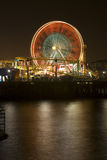 Santa Monica Ferris Wheel 2. Vertical image of the famous Pacific Wheel at Santa Monica Pier in Southern California with a roller coaster ride in the foreground Royalty Free Stock Images