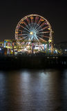 Santa Monica Ferris Wheel 3. Vertical image of the famous Pacific Wheel at Santa Monica Pier in Southern California with a roller coaster ride in the foreground Royalty Free Stock Photos