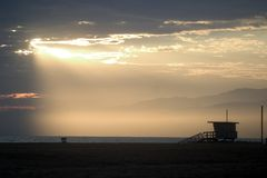 Santa Monica Lifeguard Stand. Santa Monica, California lifeguard stand with the sun bursting through the clouds Stock Photo