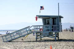 Santa Monica Lifeguard Tower in California. A lifeguard in tower on the beach in California royalty free stock photo