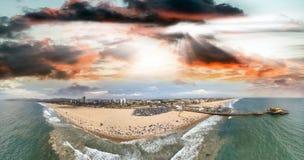 Santa Monica Pier and Beach, CA. Sunset panoramic aerial view.  Stock Image