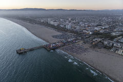 Santa Monica Pier and Beach Twilight Aerial. Santa Monica, California, USA - July 21, 2016:  After sunset twilight aerial of large crowd gathered at the Santa Royalty Free Stock Photos