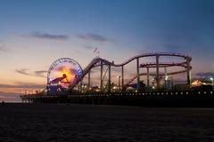 The Santa Monica Pier at dusk Stock Photo