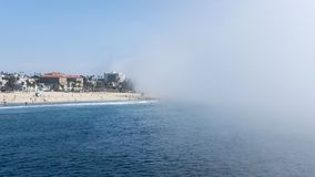 Santa Monica Pier, Los Angeles, California, USA - September 29, 2017. Peculiar weather with sudden, fast fog drifting from Venice Beach towards the iconic stock photo