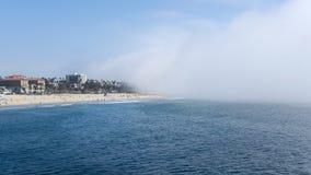 Santa Monica Pier, Los Angeles, California, USA - September 29, 2017. Sudden fog covering fast Los Angeles coast, from Venice Beach towards Santa Monica Beach stock images