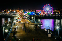 The Santa Monica Pier at night  Stock Photos
