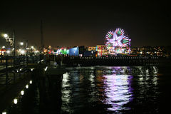 Santa Monica pier at night. With the ferris wheel reflecting in the water Stock Images