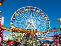 Santa Monica Pier Pacific Park Amusement Rides. Famous Santa Monica Pacific Park ferris wheel and amusement rides located on the Santa Monica pier over the Stock Image