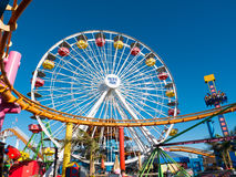 Santa Monica Pier Pacific Park Amusement Rides. Famous Santa Monica Pacific Park ferris wheel and amusement rides located on the Santa Monica pier over the Royalty Free Stock Image