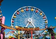 Santa Monica Pier Pacific Park Amusement Rides. Famous Santa Monica Pacific Park ferris wheel and amusement rides located on the Santa Monica pier over the Royalty Free Stock Images